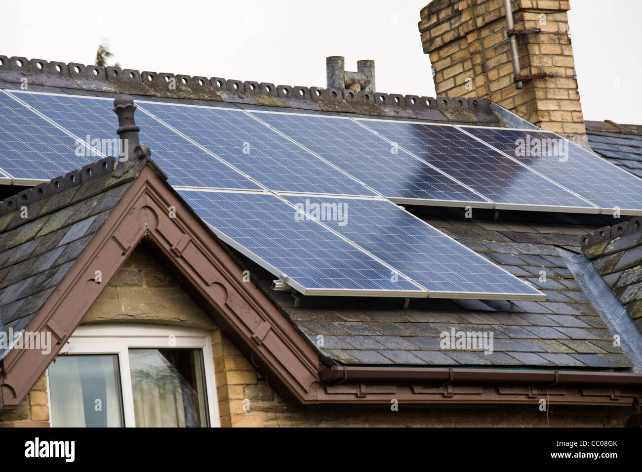 Solar panels fitted to roof of rural detached period house in Clyro Powys Wales UK - Stock Image