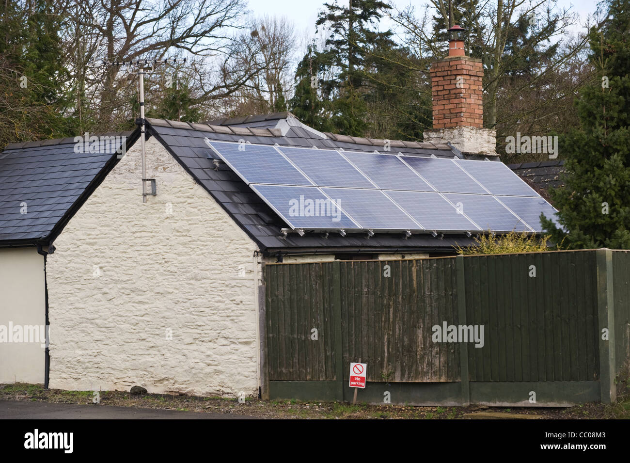 Solar panels fitted to roof of rural detached cottage in Winforton Herefordshire England UK - Stock Image