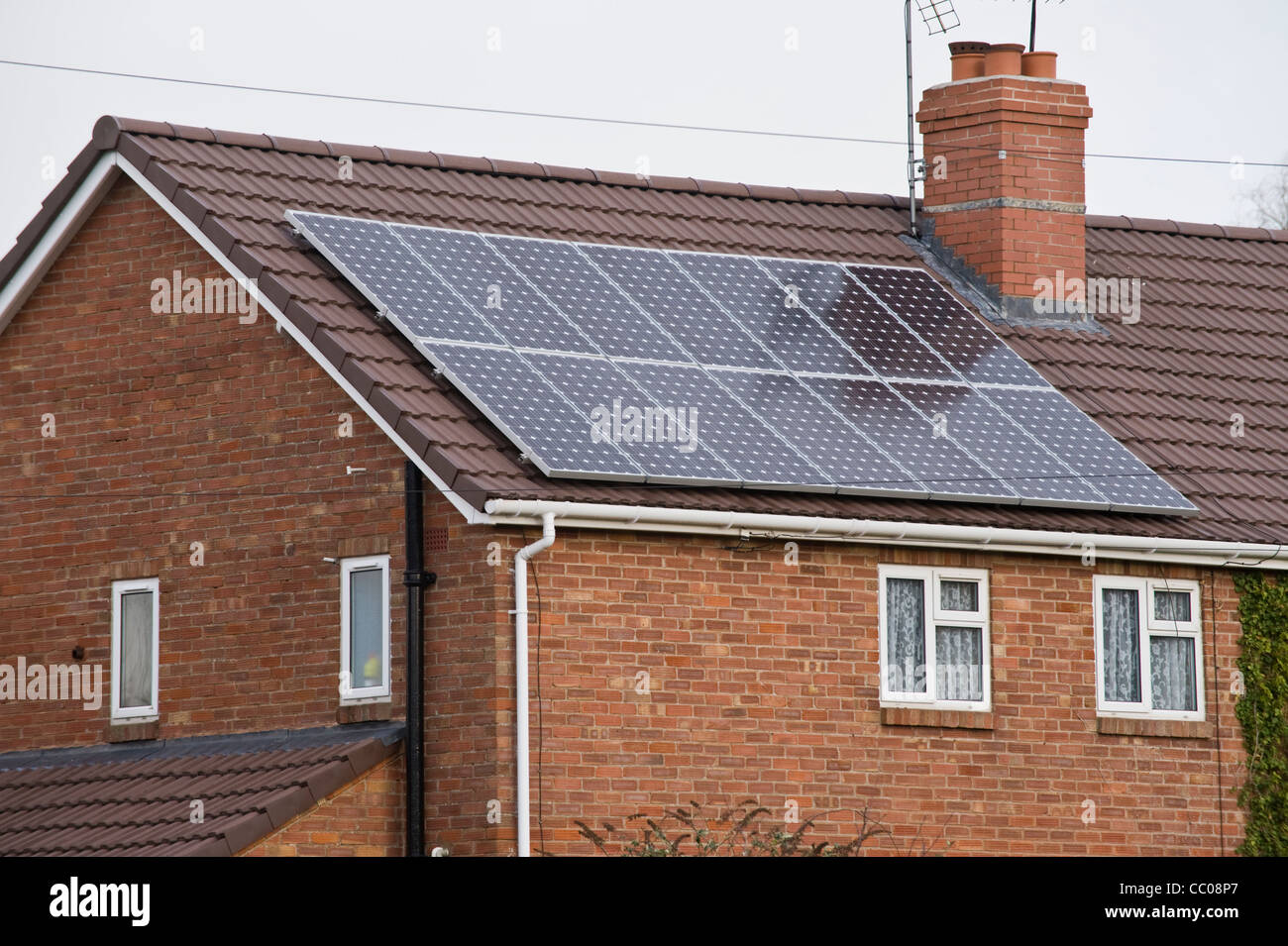 Solar panels fitted to roof of rural modern semi detached family house in Winforton Herefordshire England UK - Stock Image