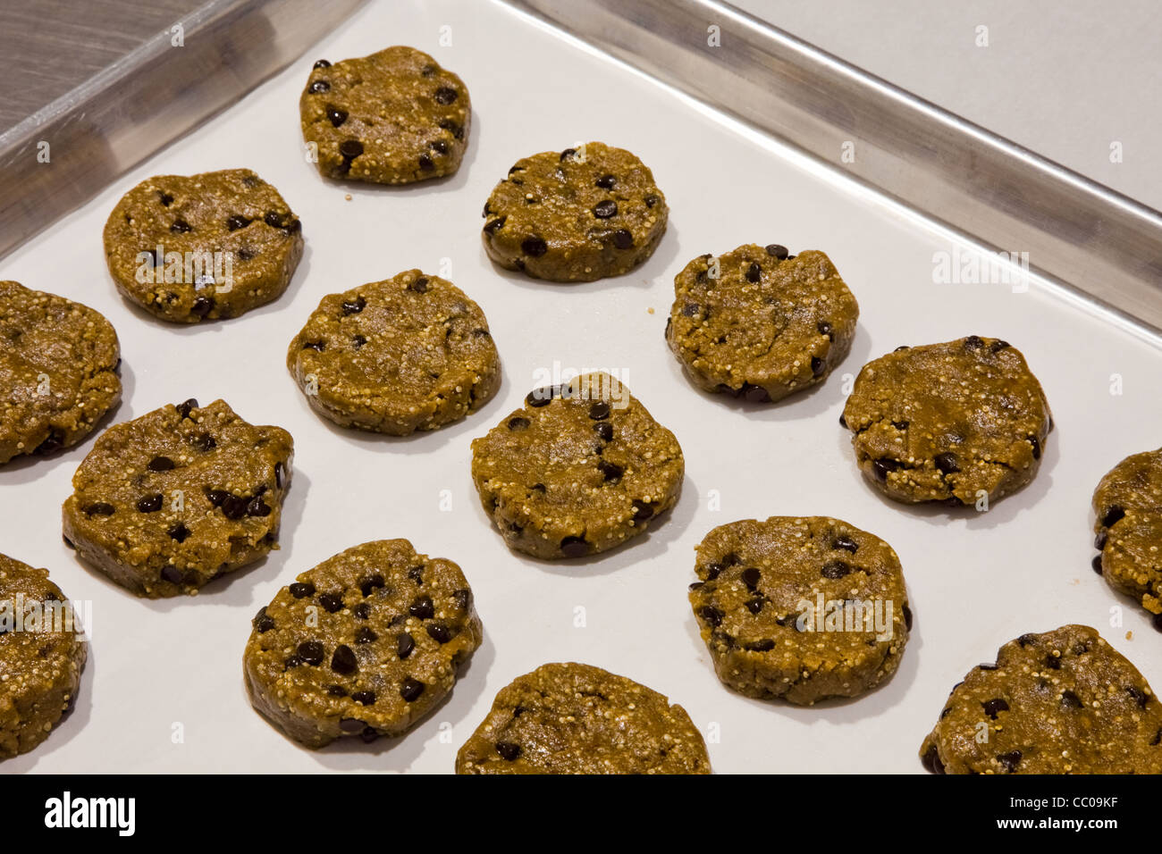An array of gluten-free cookies waiting to be baked - Stock Image