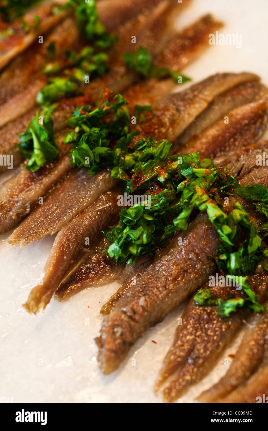 Anchovies displayed on a marble platter for a party - Stock Image