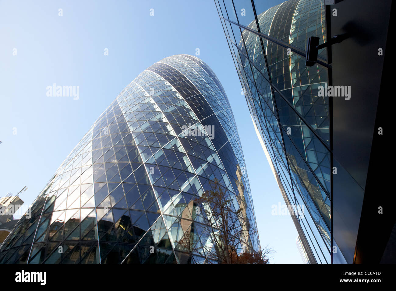 The swiss re gherkin building at 30 St Mary Axe city of London England UK United kingdom - Stock Image