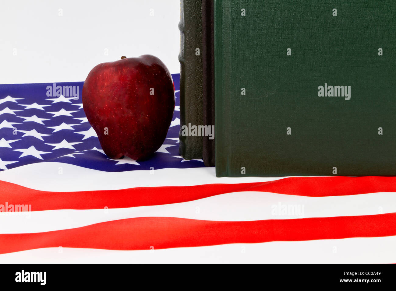 A Red Apple And Books Symbols Of Teachers And Schools Is Placed On