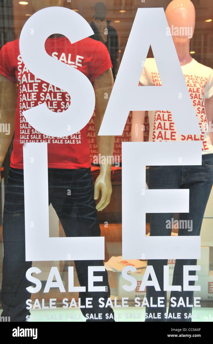 Uniqlo sale January Sales London Retail sales sale signs Oxford street  London 2012 - Stock Image 547de5c57