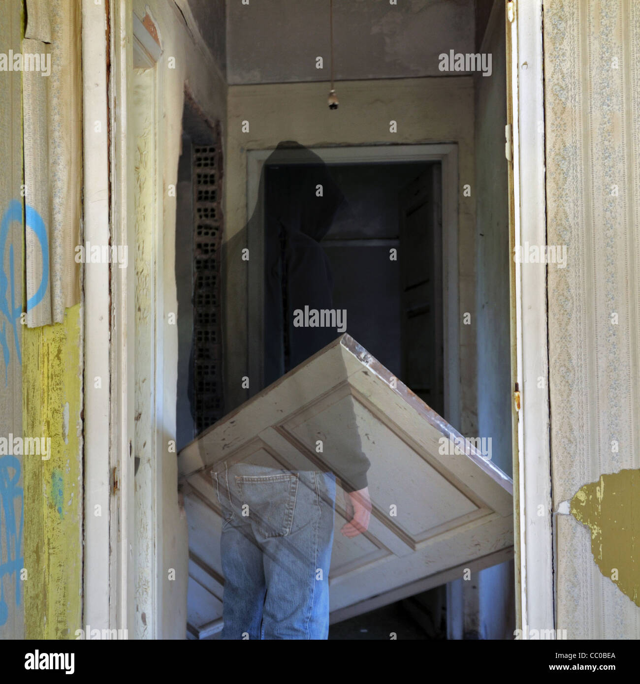 Ghost and unhinged door in the haunted hallway of an abandoned house & Ghost and unhinged door in the haunted hallway of an abandoned house ...