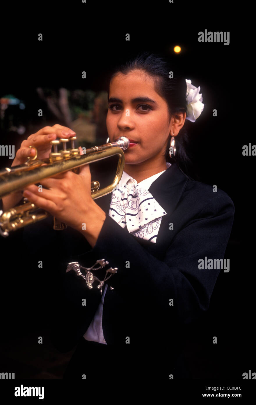 1, one, Mexican woman playing horn, horn player, mariachi band member, Tlaquepaque, Jalisco State, Mexico - Stock Image