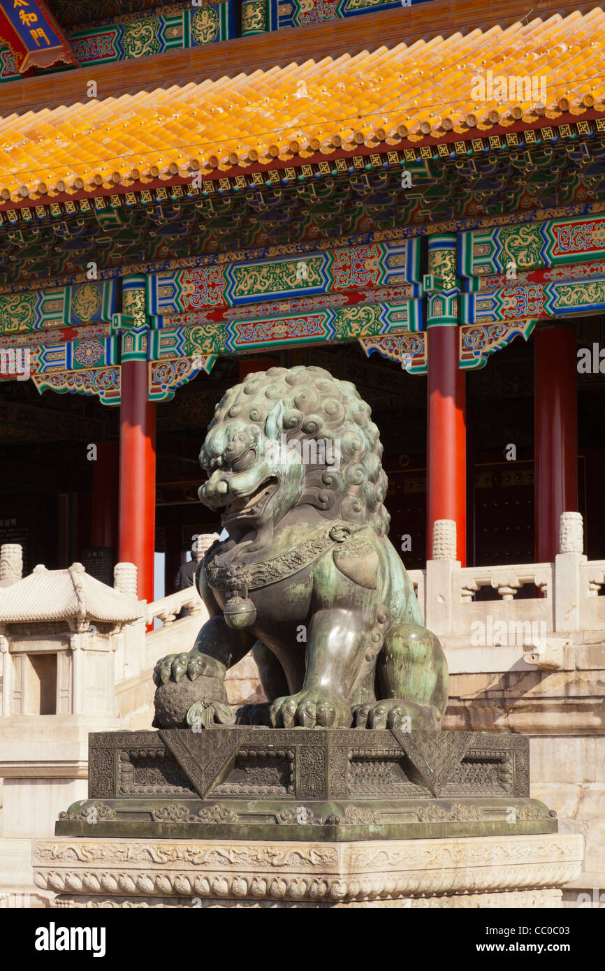 A bronze lion guarding the western approach to the Gate of Supreme Harmony in the Forbidden City in Beijing, China - Stock Image