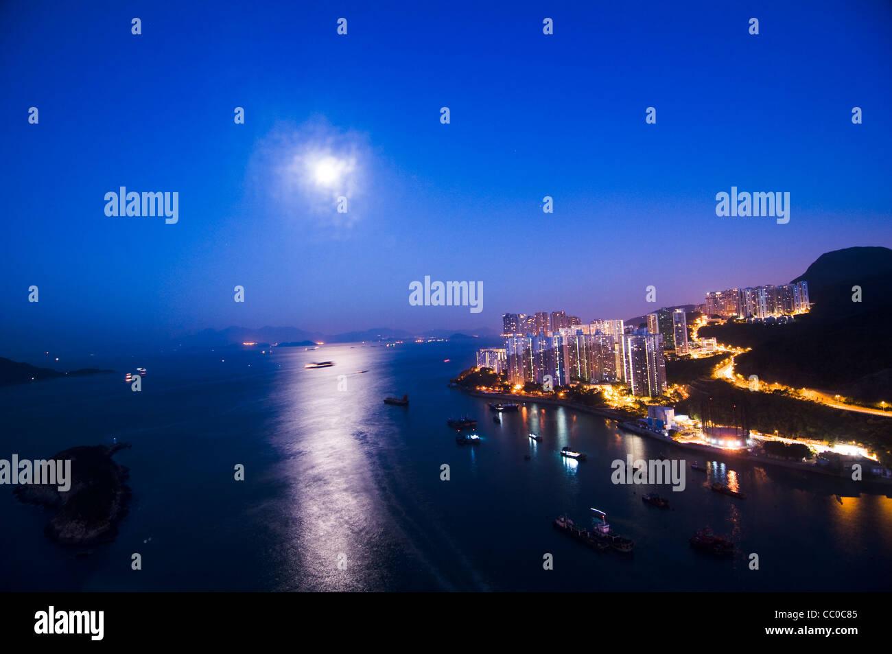 Moon shining over the South China sea in Hong Kong. - Stock Image
