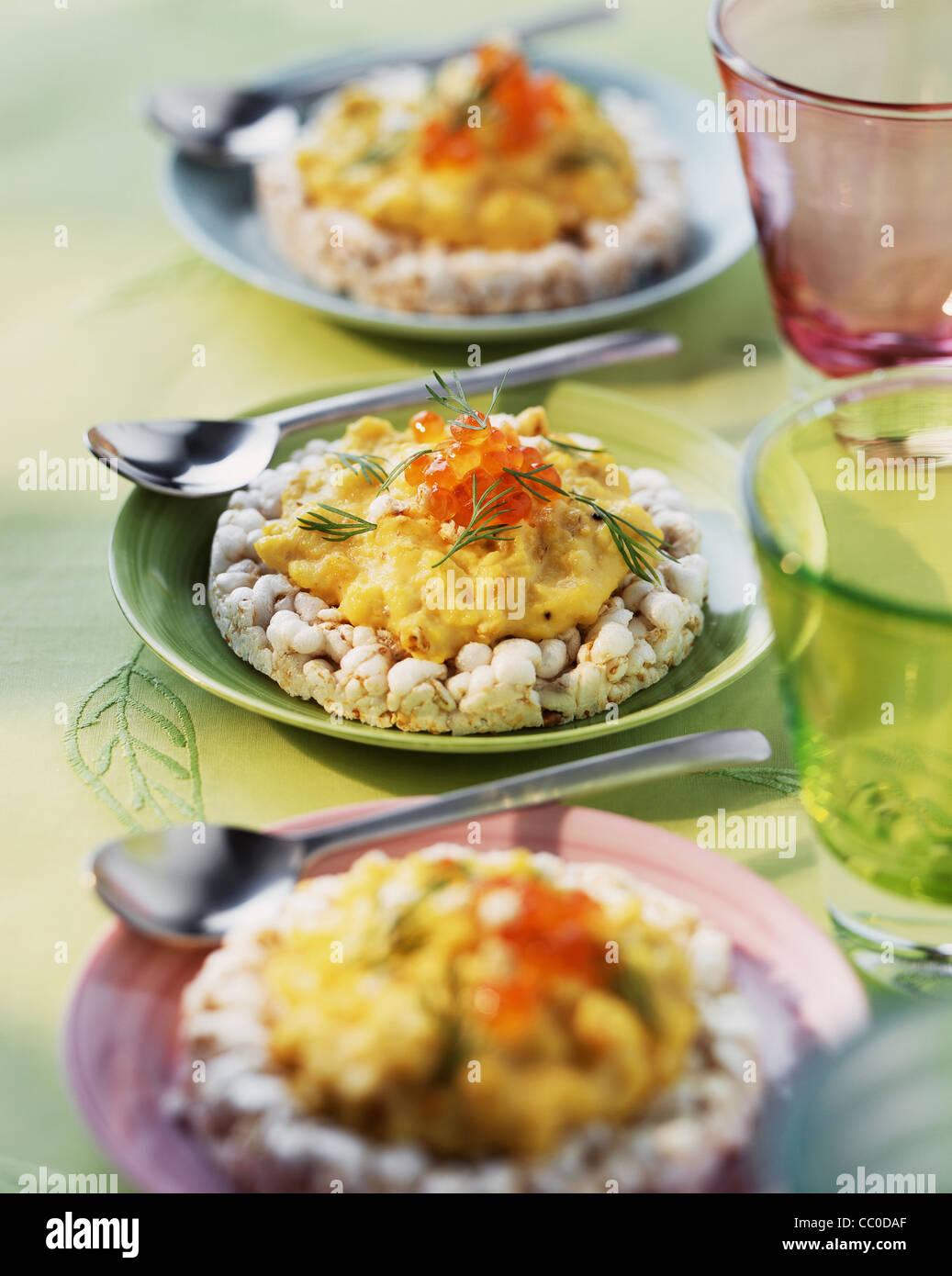 cooking Scramble Eggs on Rice Crispy - Stock Image