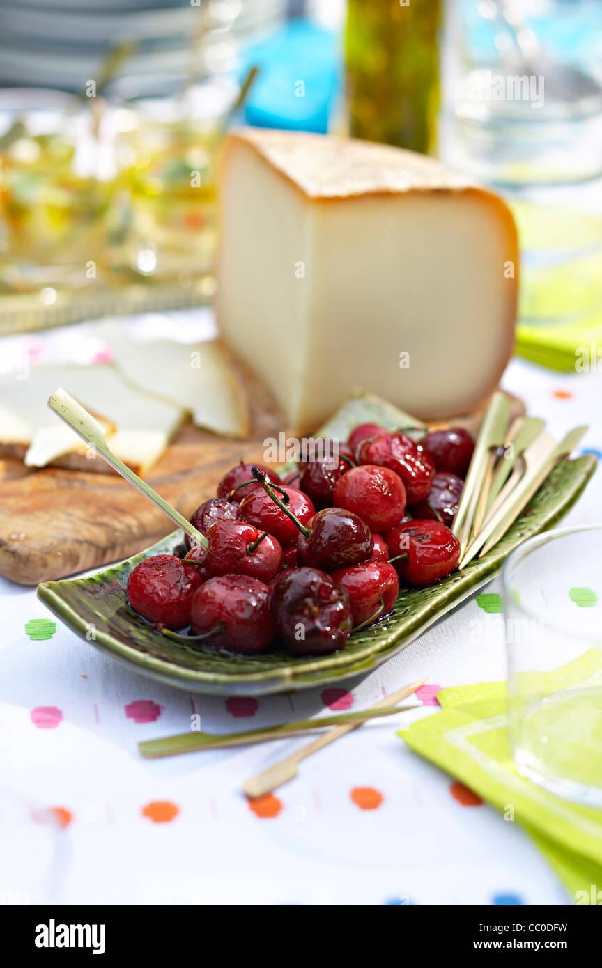 Ewe Cheese and Cherries - Stock Image