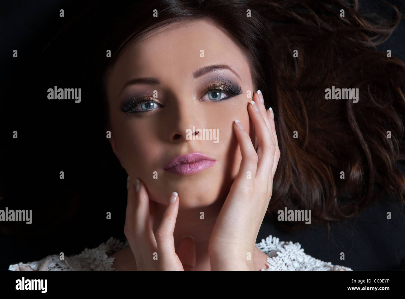 Beautiful young woman hands on face - Stock Image
