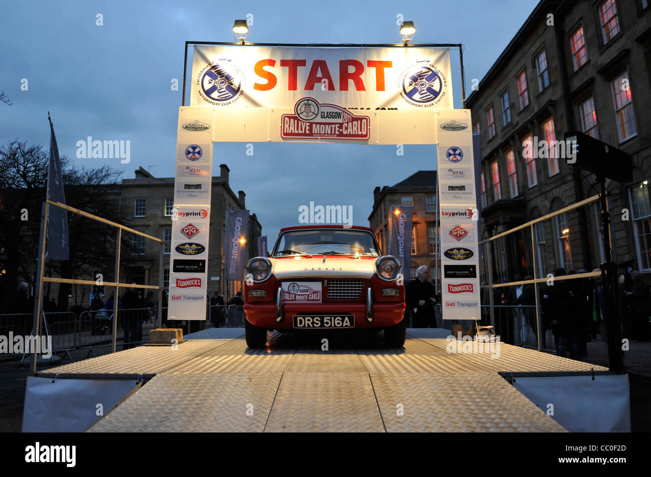 Cars leave Glasgow's George Square at the start of the historic Rallye Monte Carlo - Stock Image