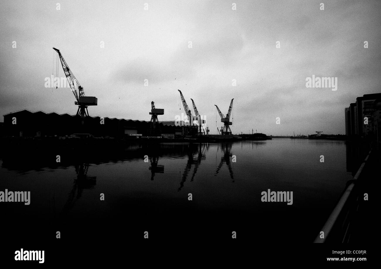 View along River Clyde, Glasgow, Scotland showing cranes and other shipbuilding industry - Stock Image