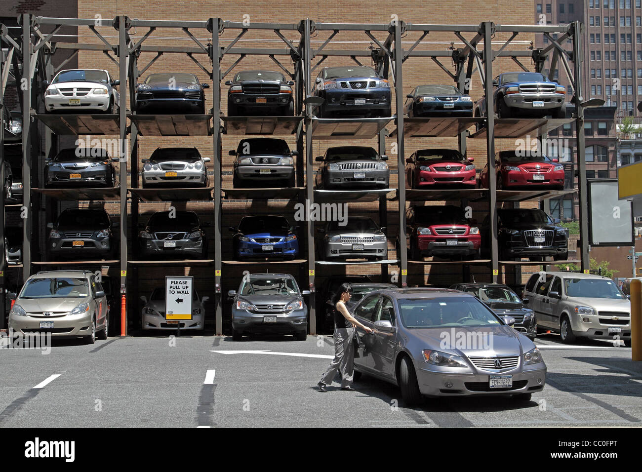 SUPERPOSITION OF CARS IN A MULTISTORY CAR PARK, MIDTOWN MANHATTAN, NEW YORK CITY, NEW YORK STATE, UNITED STATES - Stock Image