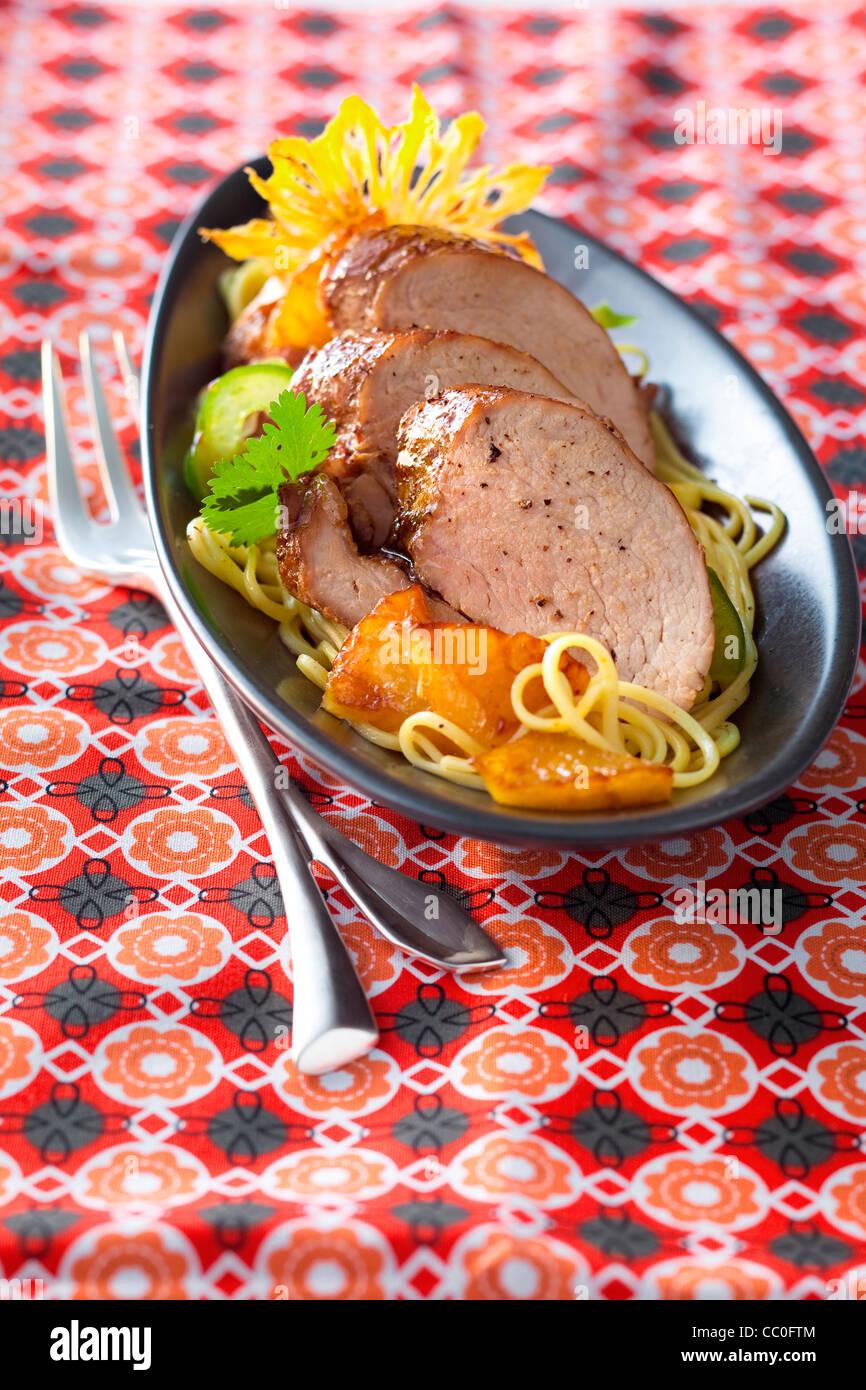 Roast Glazed Pork with Pineapple - Stock Image