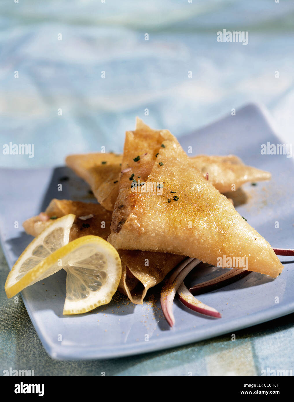 Crispy triangles with ricotta and herbs - Stock Image