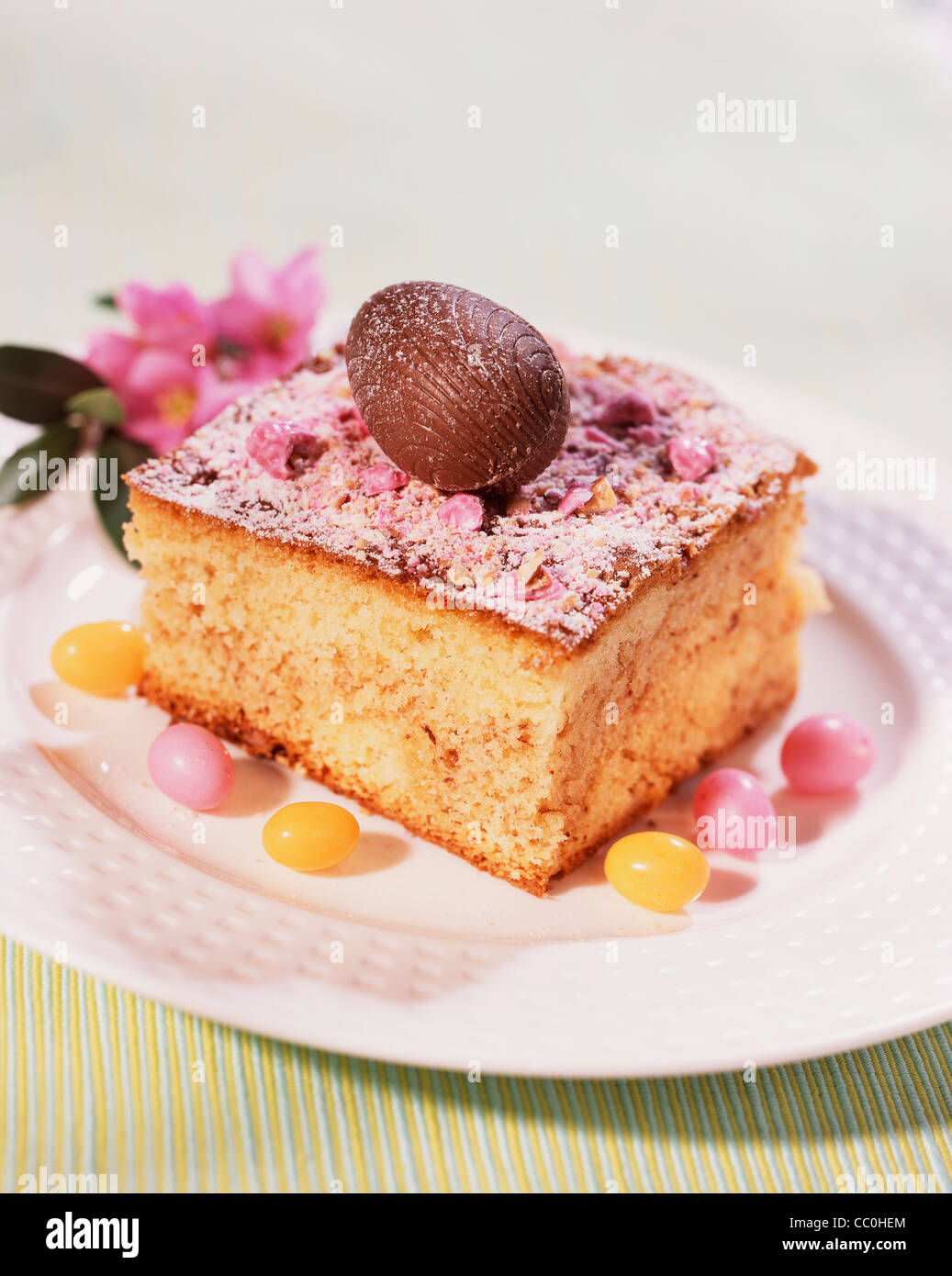 cooking Fluffy Cake with Pralines - Stock Image