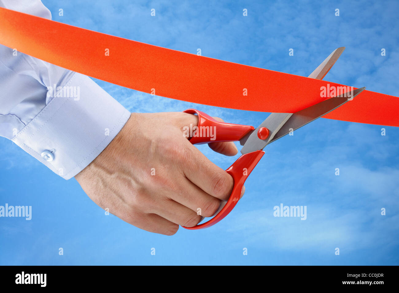 Cutting a red ribbon - Stock Image