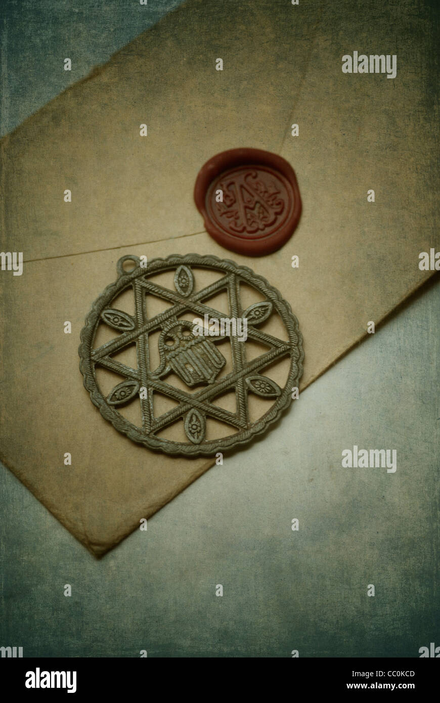 Star of David over a brown envelope sealed with red wax - Stock Image
