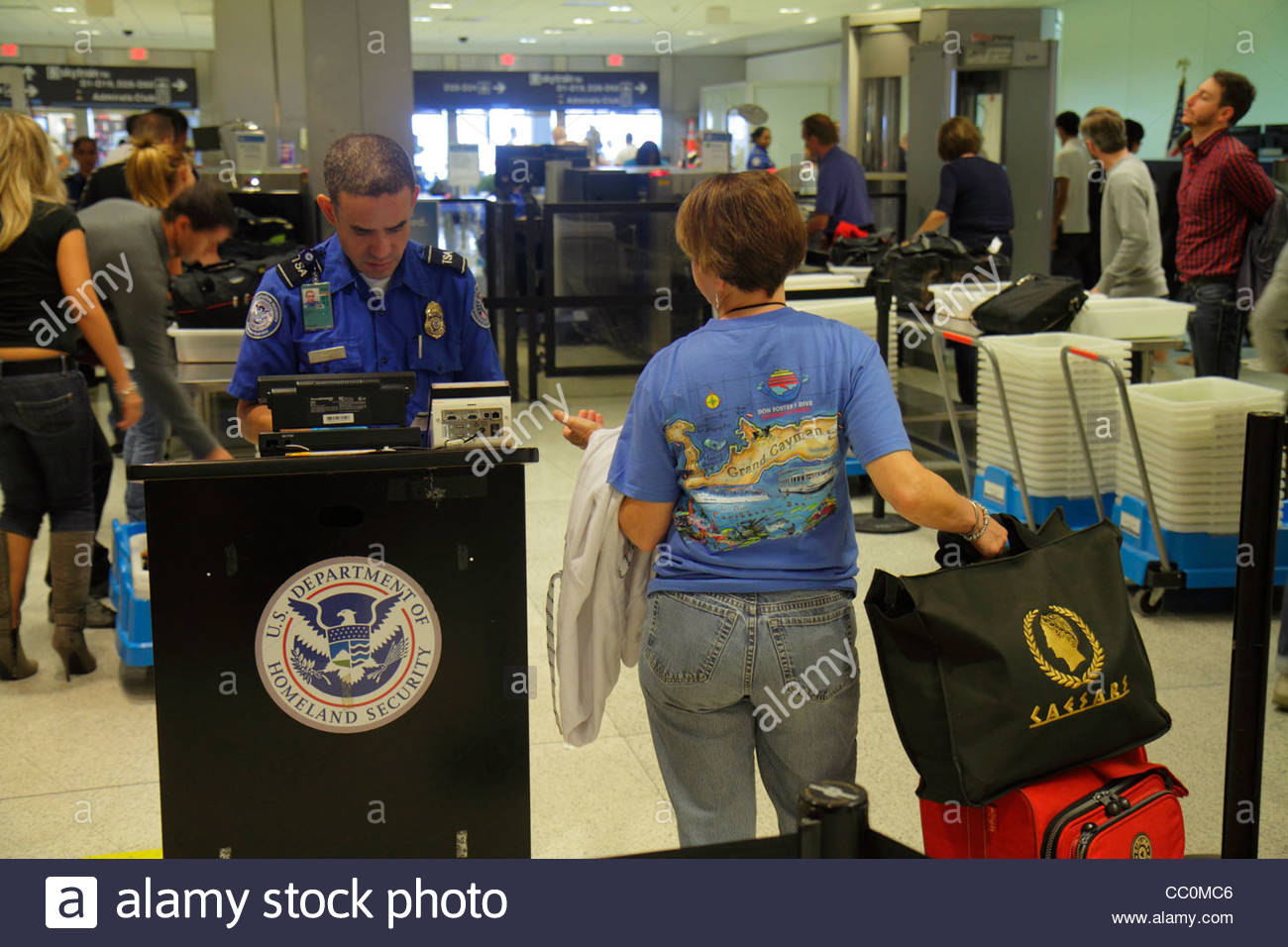 Miami Florida International Airport MIA aviation Department of Homeland Security TSA checkpoint anti-terrorism safety - Stock Image