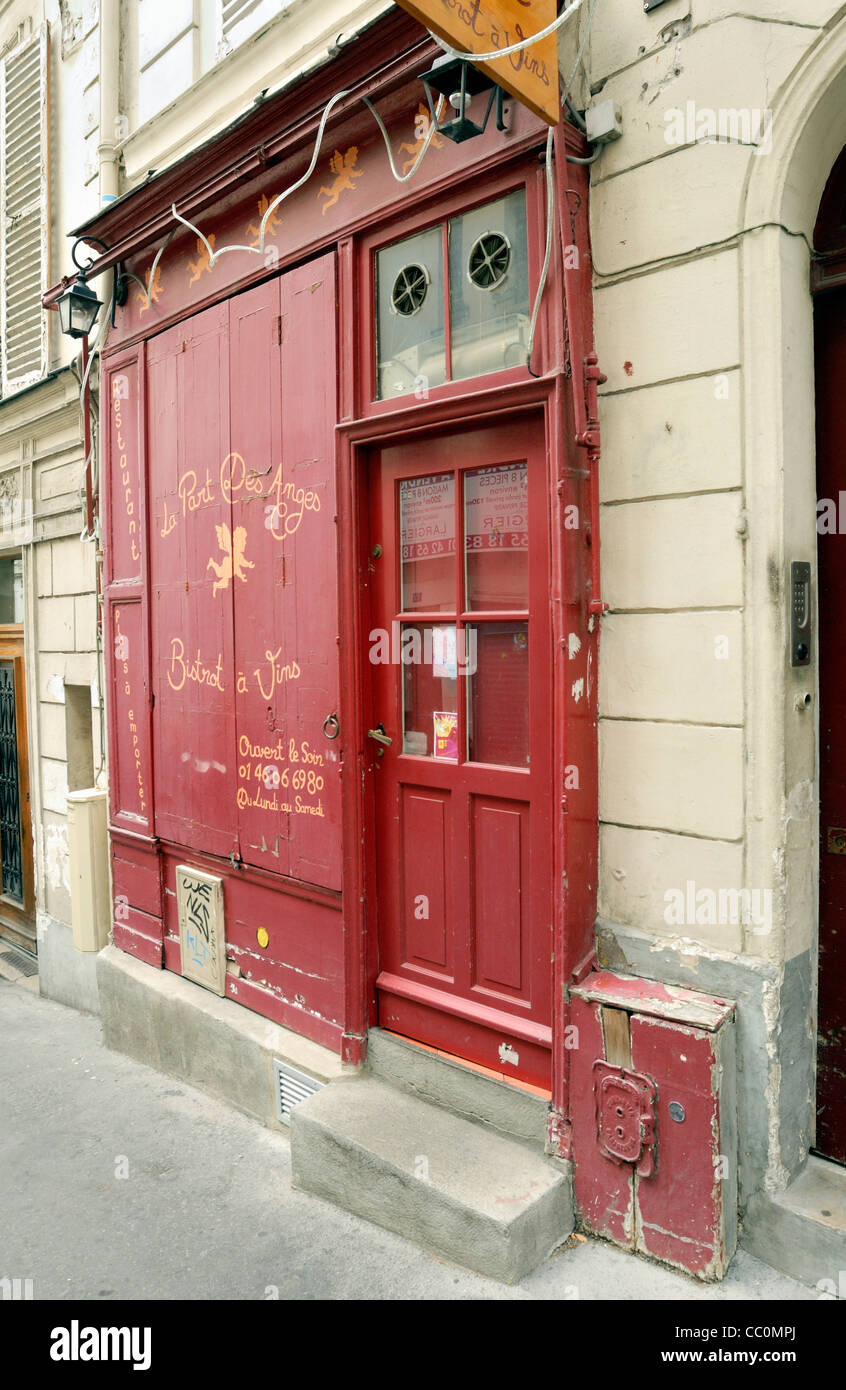 Paris restaurant with its brightly painted red doors closed for business on Sunday, - Stock Image