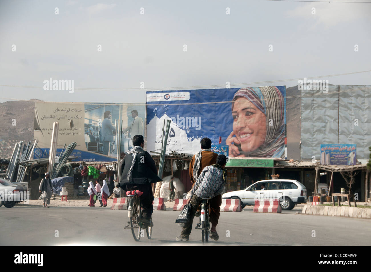 Kabul. Advert for mobile phone, using a photo of a woman. - Stock Image