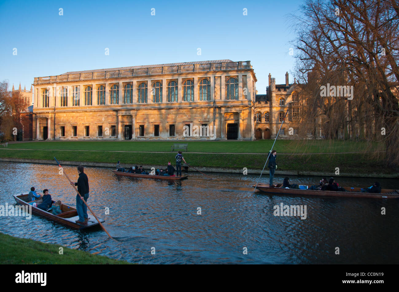 The Wren Library at sunset, Trinity College Cambridge, with punting in front on the river Cam, UK - Stock Image