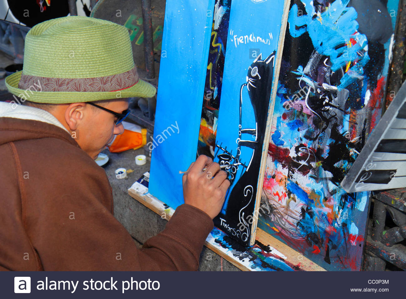 New Orleans Louisiana French Quarter Decatur Street Jackson Square landmark fence open-air artist colony vendor - Stock Image