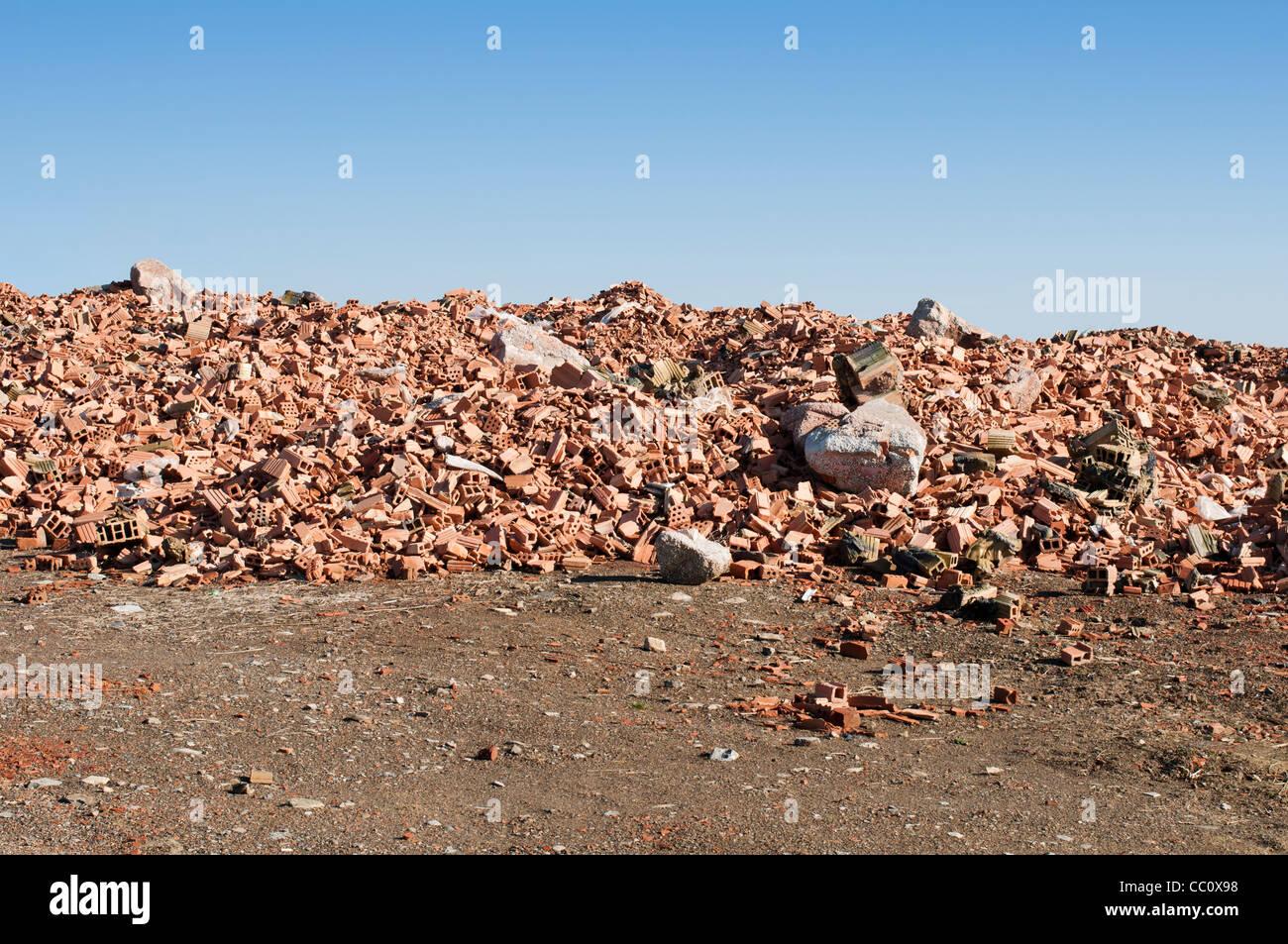 Landfill for disposal of construction waste. Brick debris - Stock Image