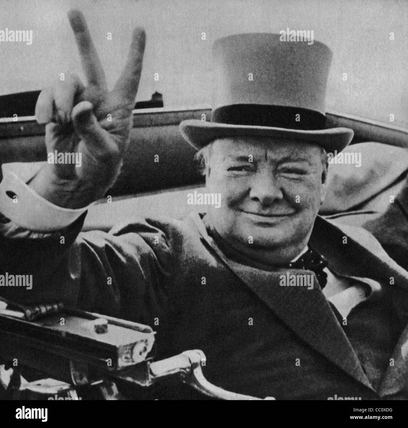 British wartime leader Winston Churchill with his famous V for victory sign. Image from the archives of Press Portrait - Stock Image