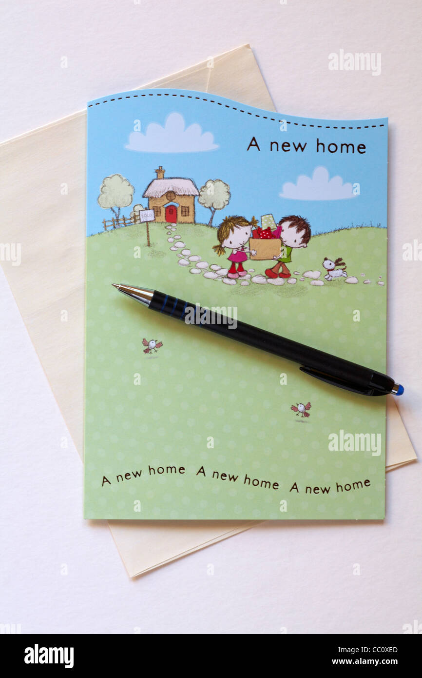getting ready to write a new home card with pen set on white stock