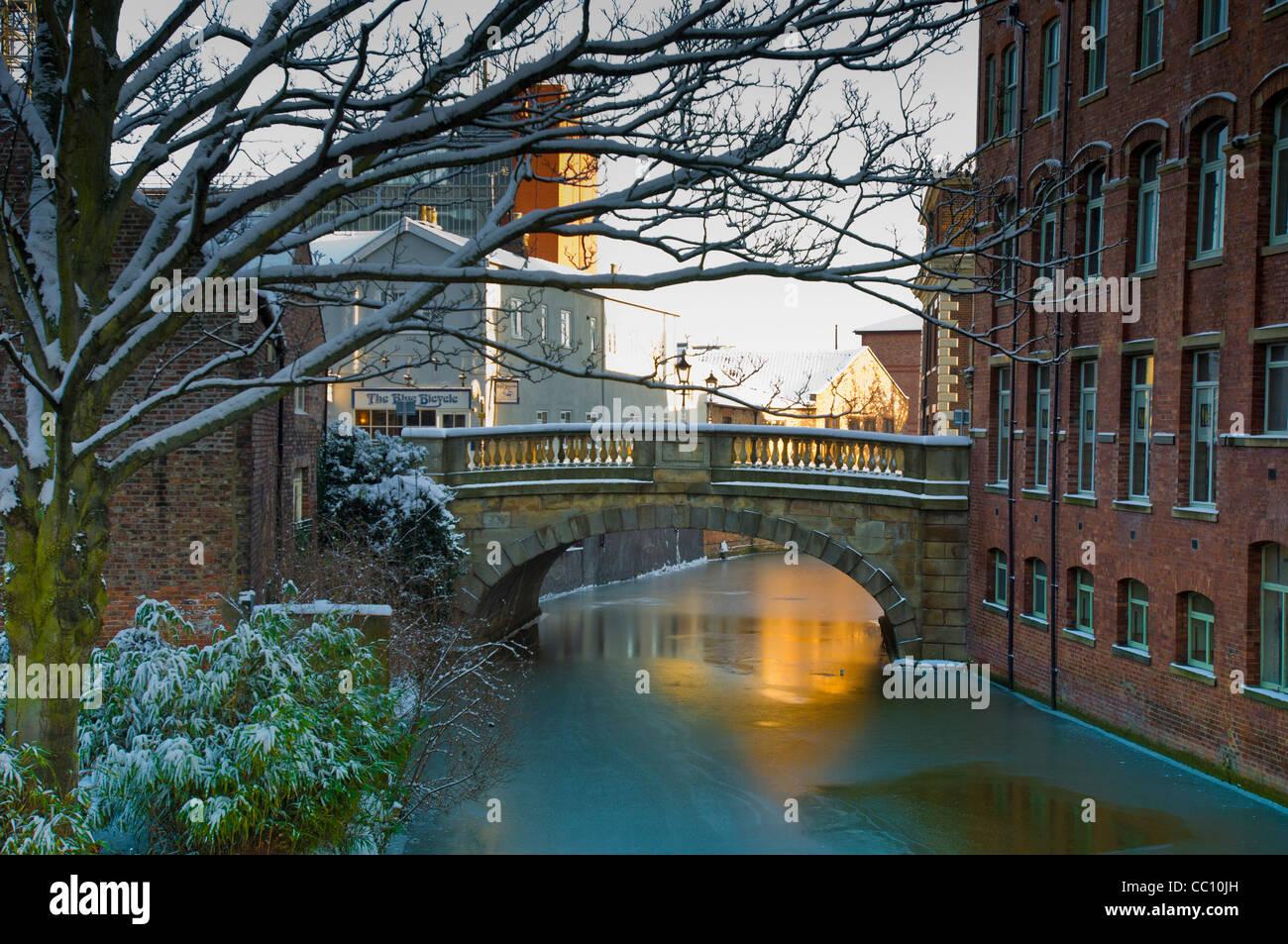 Bridge over frozen river Foss in Fossgate, york. - Stock Image
