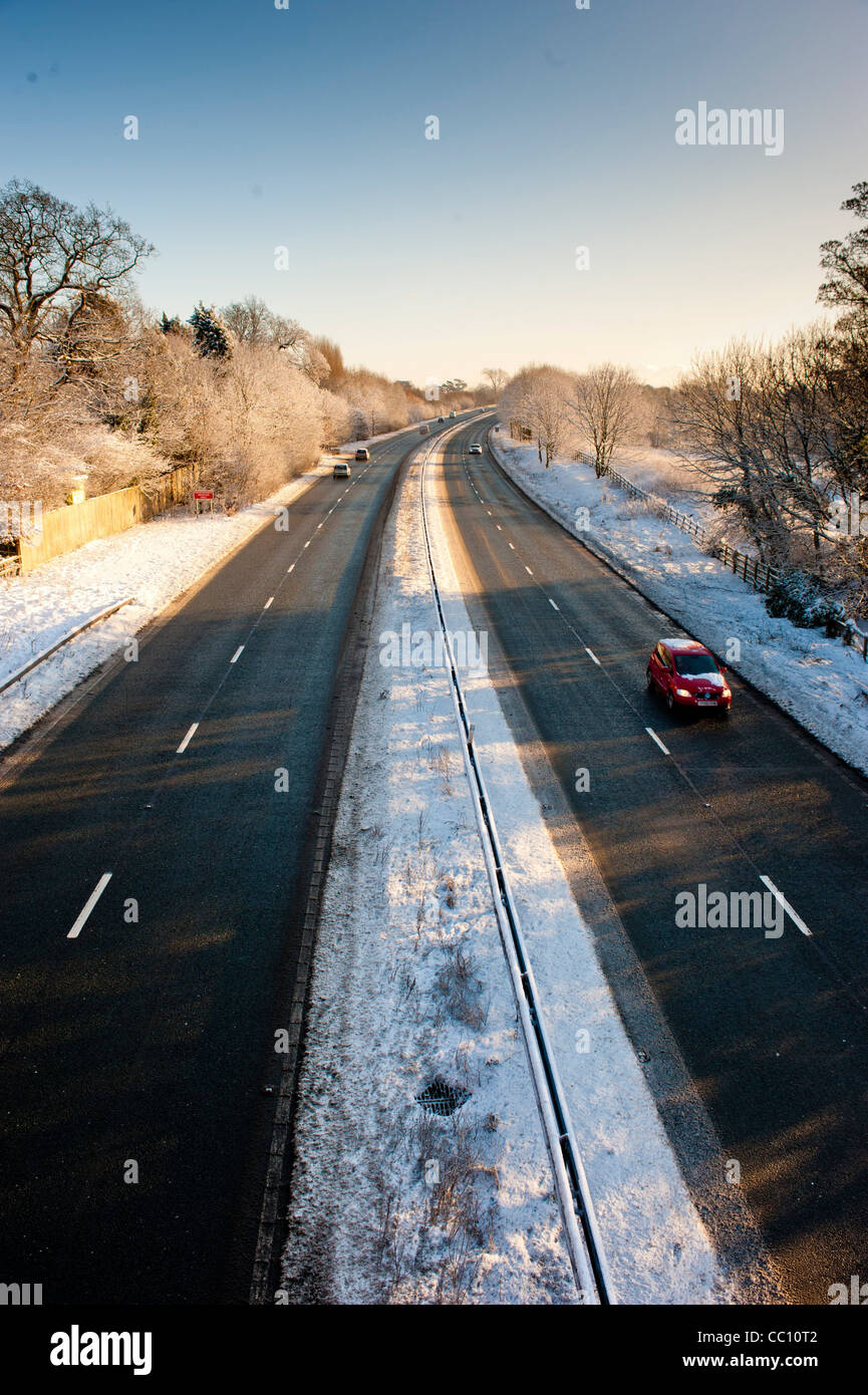 Cars on snow cleared dual carriageway, UK - Stock Image