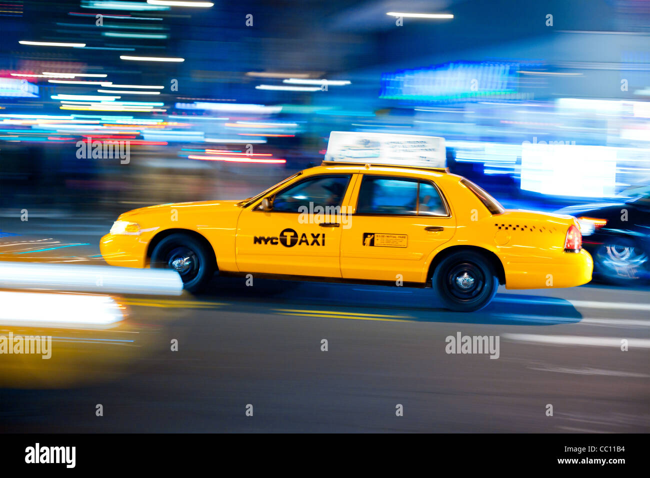 Yellow cab at street. Taxi Cab Manhattan, New York, USA. New York taxi driver goes fast. - Stock Image