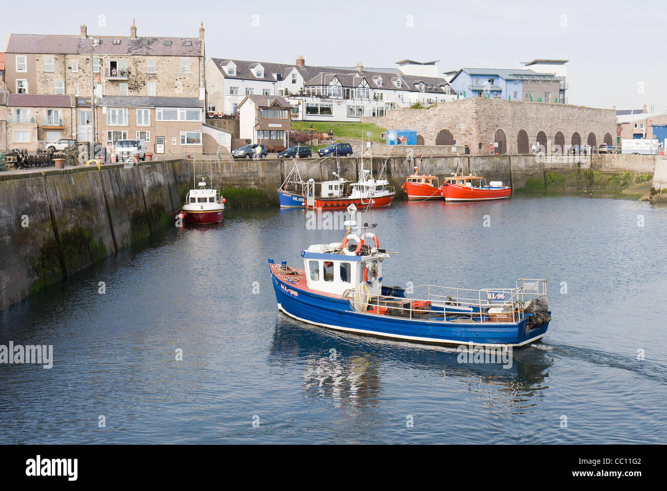 Boats in Seahouses Harbour on a summer's day Stock Photo
