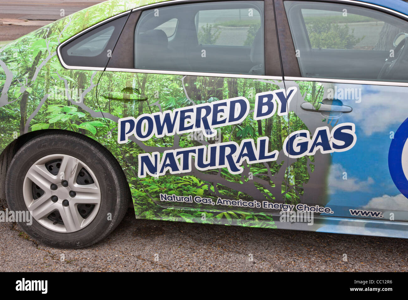 Passenger vehicle powered with natural gas. - Stock Image