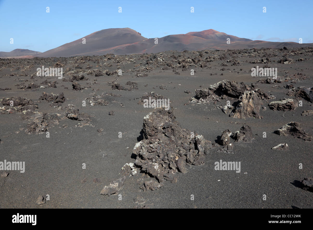 View over a lava field towards the Montanas del Fuego. on Canary Island Lanzarote - Stock Image