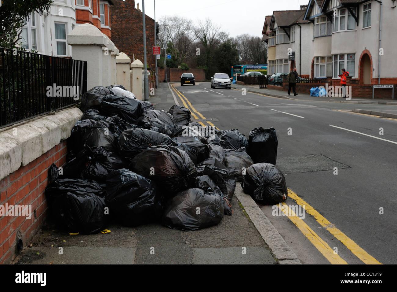 Pile of black bin bags - Stock Image