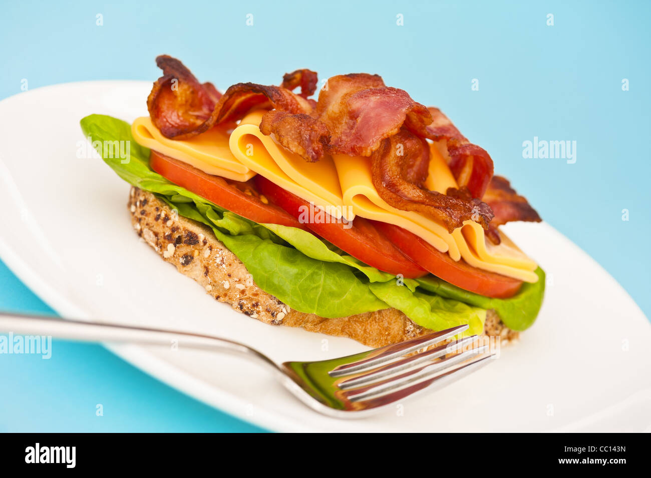 Open Sandwich With Melted Cheese And Salad Decoration Stock Photo