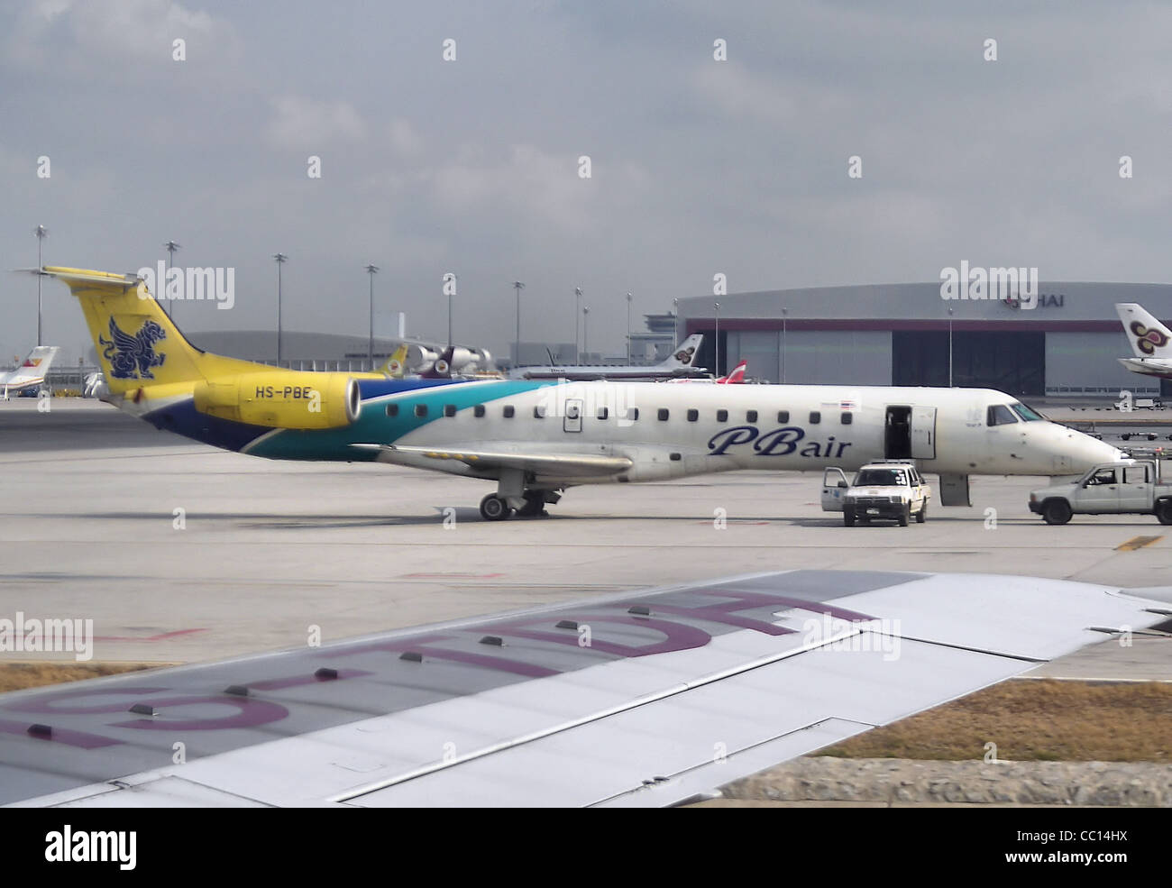 PBair Embraer ERJ-145, at Suvarnabhumi International Airport Bangkok. - Stock Image