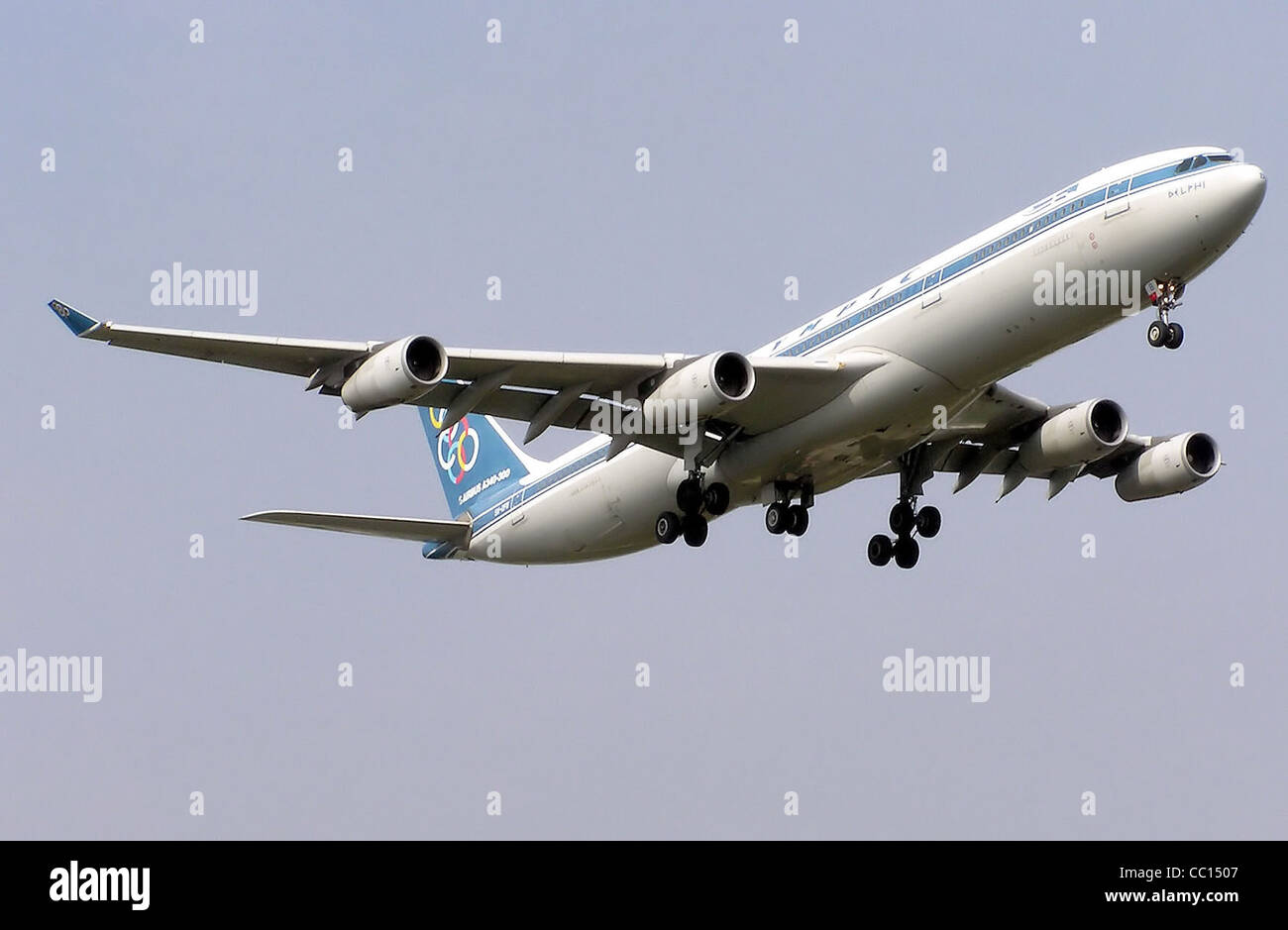 Olympic Airbus A340-300 (SX-DFB) landing at London Heathrow Airport, England. - Stock Image