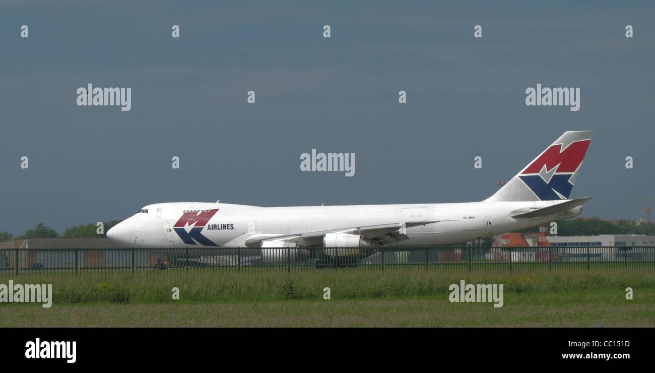 MK Airlines Boeing 747-200 landing at Ostend-Bruges International Airport, Belgium - Stock Image
