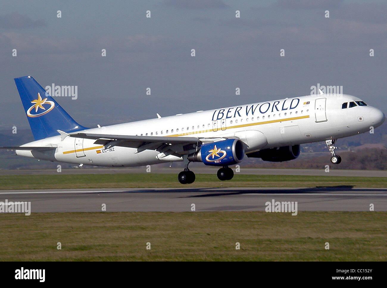 Iberworld Airbus A320-200 (EC-INZ) landing at Bristol Airport, England. - Stock Image
