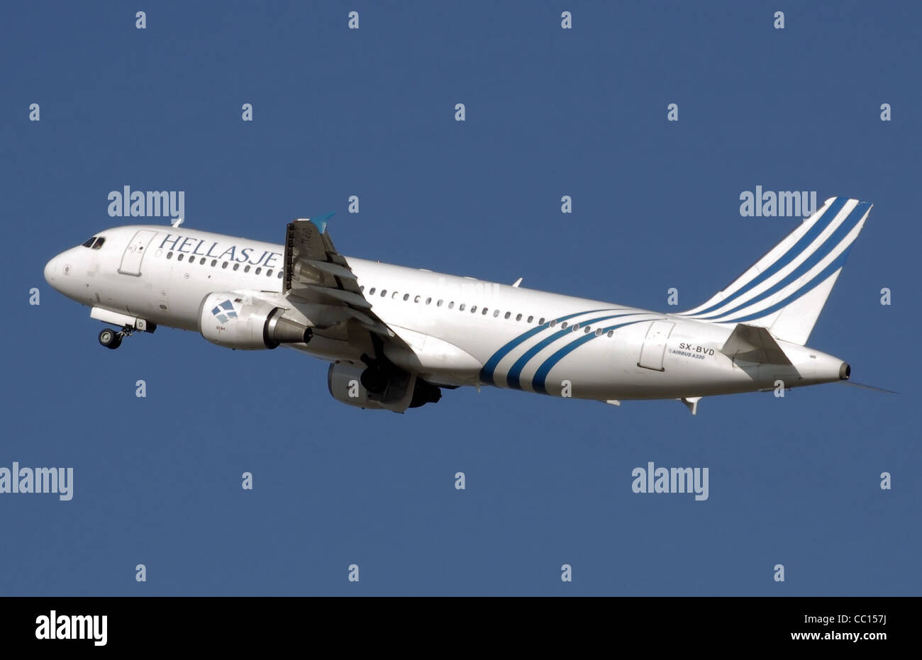 Hellas Jet Airbus A320-200 (SX-BVD) taking off from London Heathrow Airport, England. - Stock Image