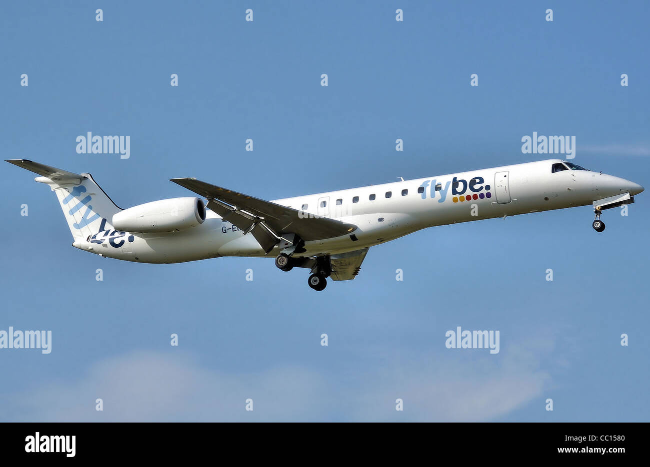 Flybe Embraer ERJ 145 (G-ERJA) lands at Birmingham International Airport, England. - Stock Image
