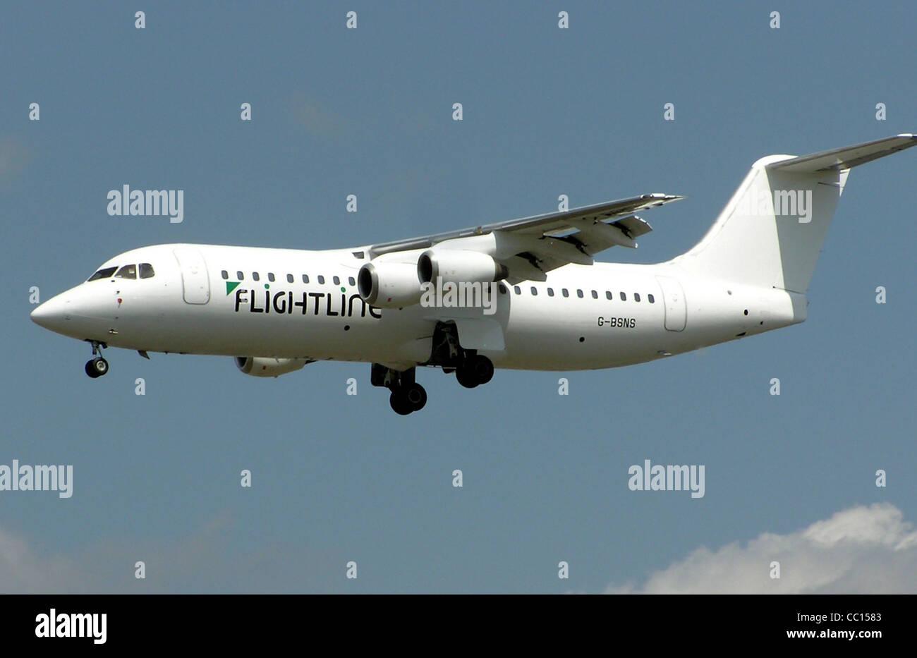 Flightline British Aerospace 146-300 (G-BSNS) landing at London Heathrow Airport. - Stock Image