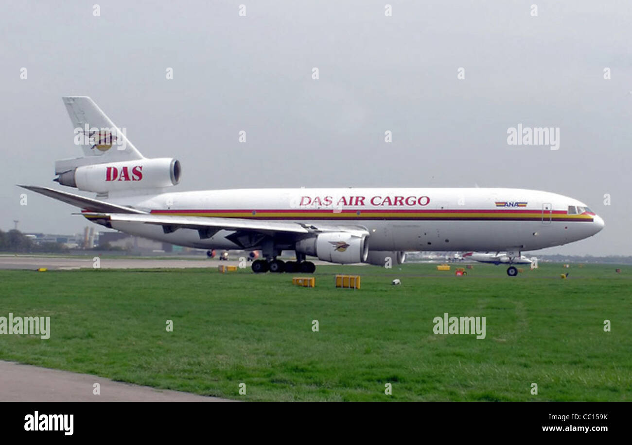 DAS Air Cargo DC-10-30 (5X-JCR) waiting for permission to take off at Gatwick Airport, England. - Stock Image