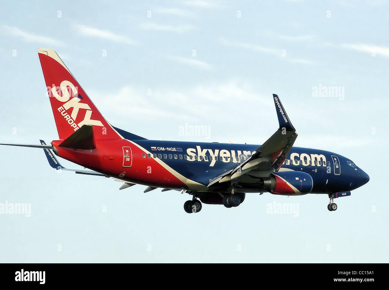 SkyEurope Airlines Boeing 737-700 (OM-NGE) lands at Birmingham International Airport, England. - Stock Image