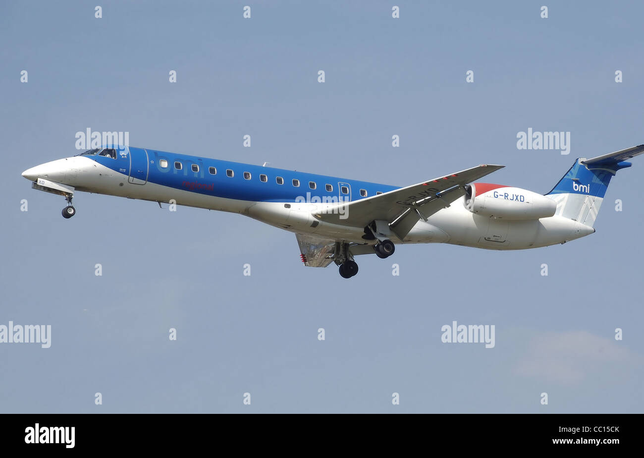 bmi Embraer ERJ 145 (G-RJXD) lands at London Heathrow Airport, England. - Stock Image