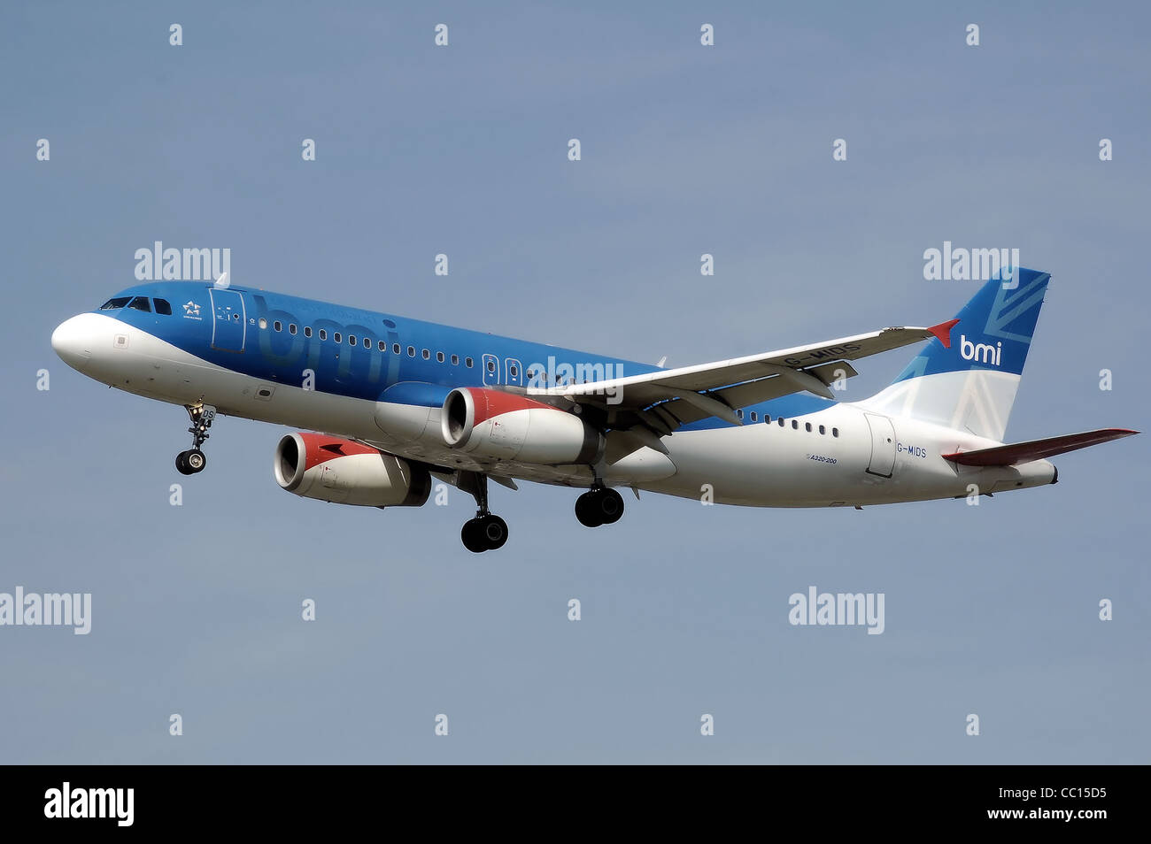 bmi Airbus A320-200 (G-MIDS) lands at London Heathrow Airport, England. - Stock Image